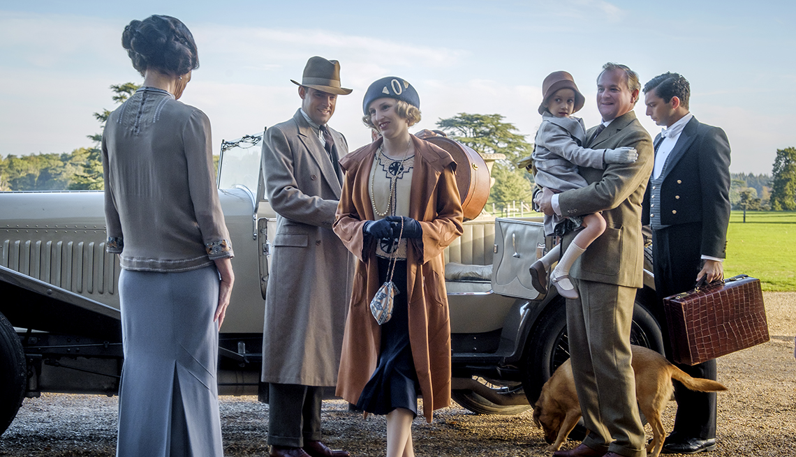 Elizabeth McGovern stars as Lady Grantham Harry Hadden Paton as Lord Hexham Laura Carmichael as Lady Hexham Hugh Bonneville as Lord Grantham and Michael Fox as Andy in the film Downton Abbey