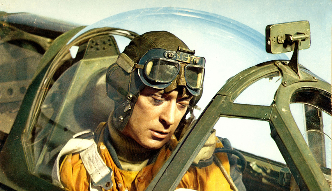 Michael Caine sitting in a cockpit of an aircraft in the film Battle of Britain