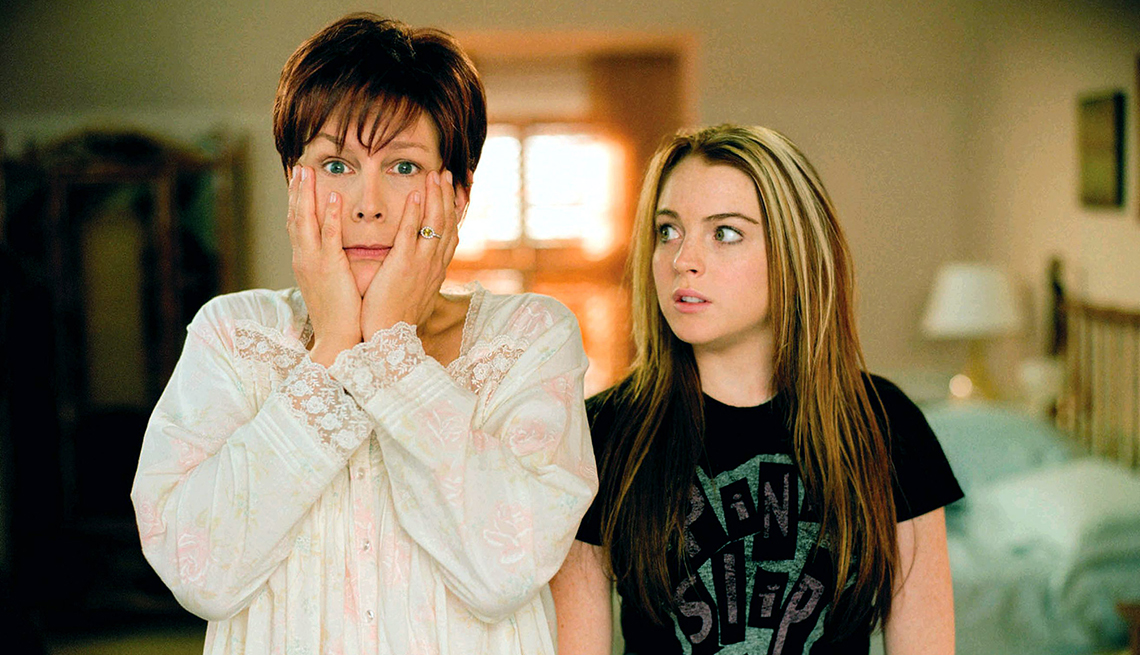 Jamie Lee Curtis places her hands on her face as Lindsay Lohan looks on in Freaky Friday