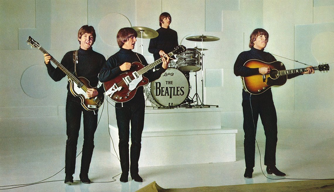 Paul McCartney George Harrison Ringo Starr and John Lennon in the 1965 film Help