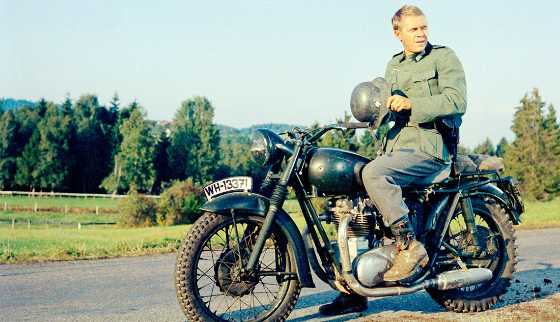 Steve McQueen sitting on a motorcycle for the film The Great Escape