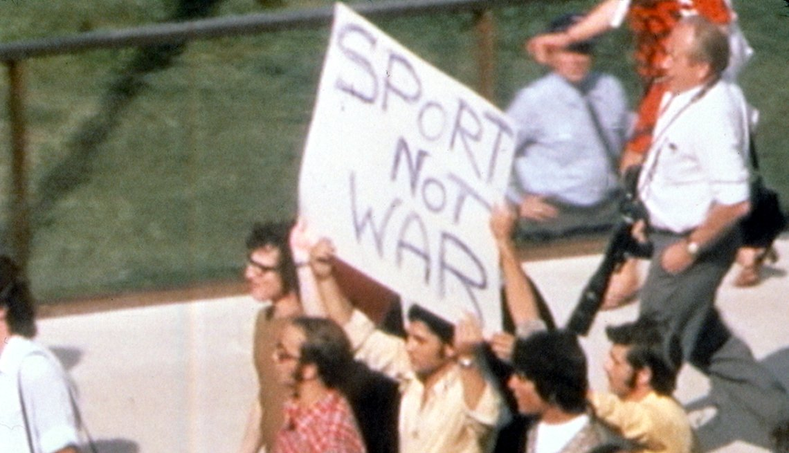 A protester holds a Sport Not War sign in the 1999 documentary One Day in September