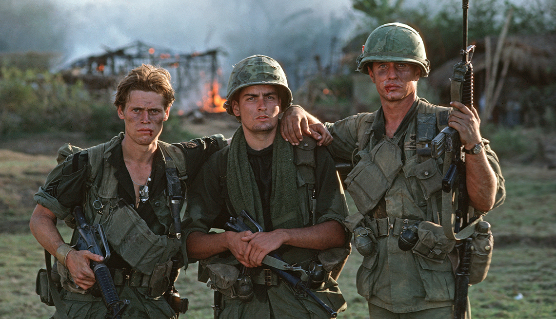 Willem Dafoe Charlie Sheen and Tom Berenger during the filming of Platoon