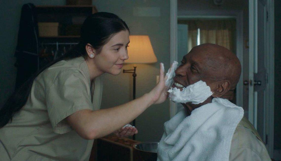 image from the movie the cuban. actress ana golija putting shaving cream on louis gossett junior's  ace