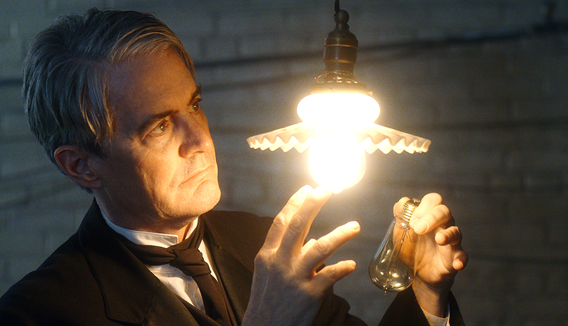 Kyle MacLachlan looks at a light bulb as he stars as Thomas Edison in the film Tesla