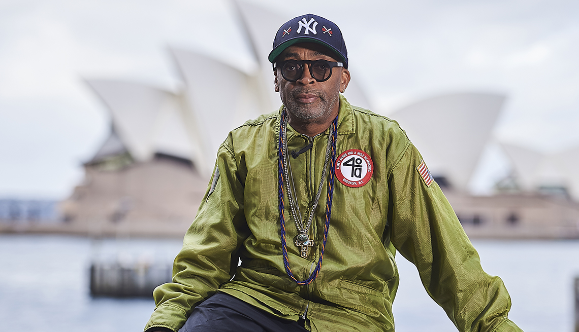 Spike Lee posing for a photo nearby the Sydney Opera House in Sydney Australia