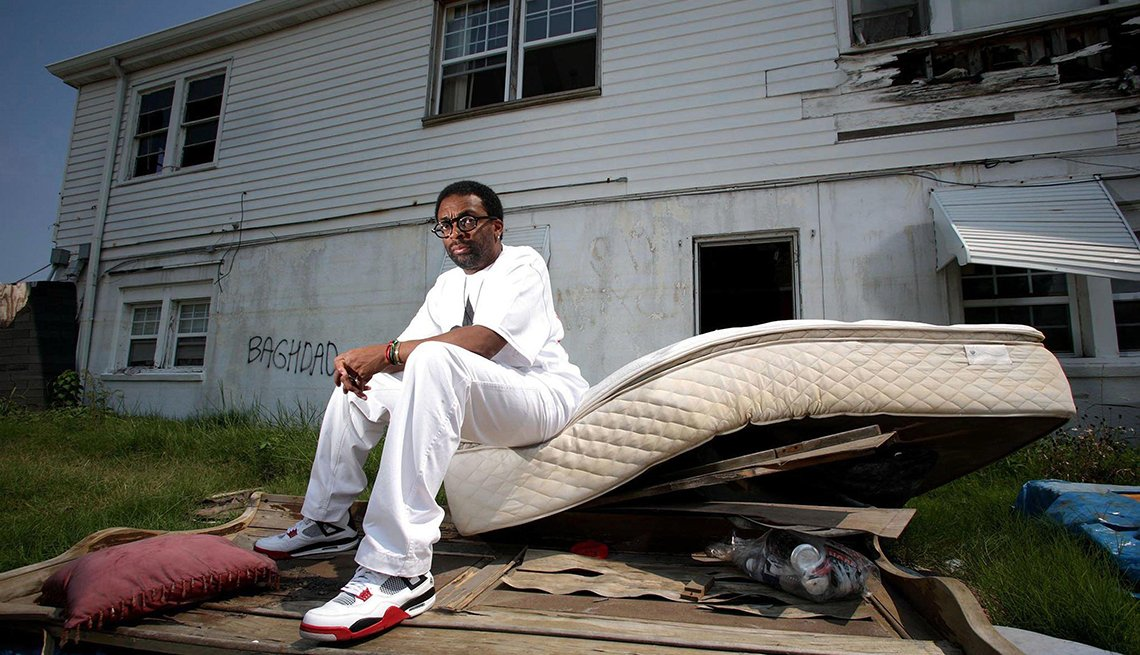 Spike Lee sitting on a mattress and other debris for a photo for the H B O documentary When the Levees Broke A Requiem in Four Acts