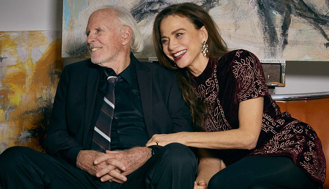 Bruce Olin and Lena Olin sitting together and smiling in a scene from The Artist's Wife