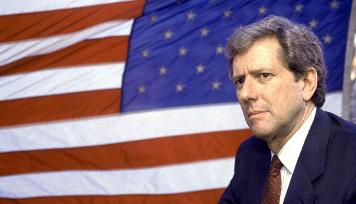 Michael Murphy in front of an American flag for the film Tanner '88