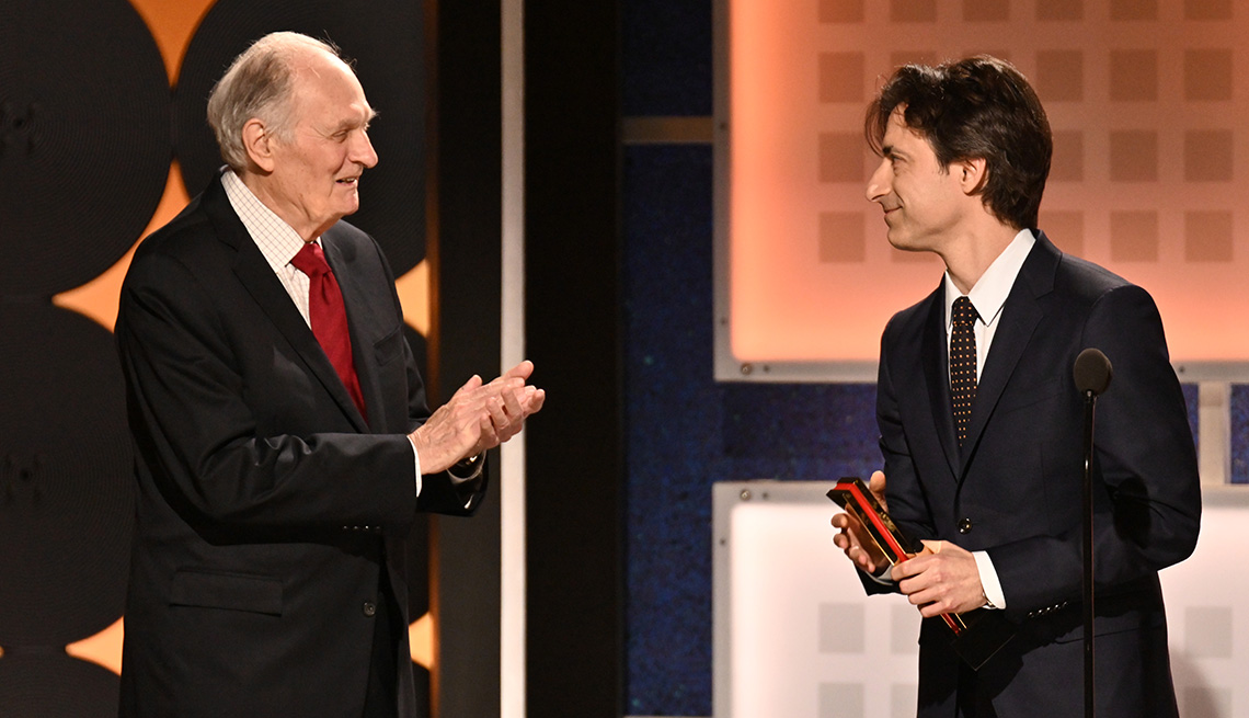 Noah Baumbach accepts Best screenwriter from presenter Alan Alda at the Movies for Grownups Award