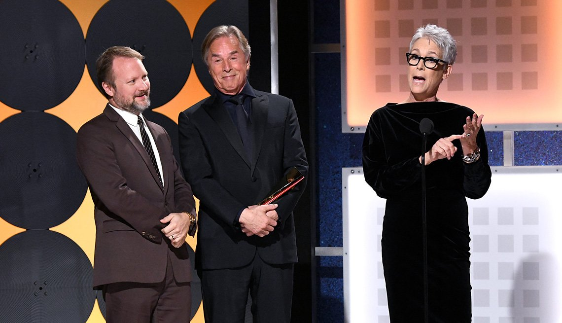 Rian Johnson Don Johnson and Jamie Lee Curtis accept the award for Best ensemble Cast at the Movies for Grownups Awards