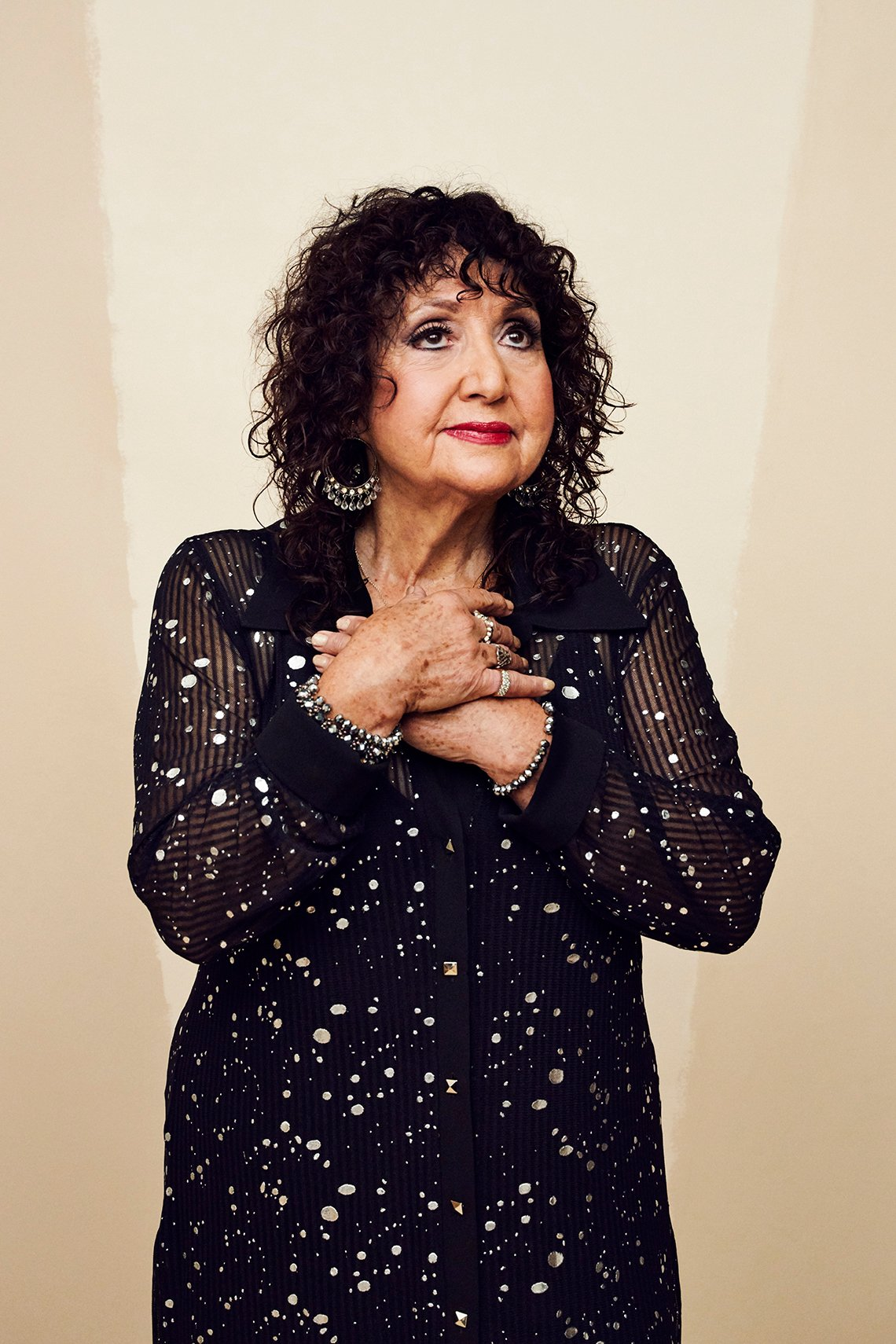 Singer Maria Muldaur with hands across her chest