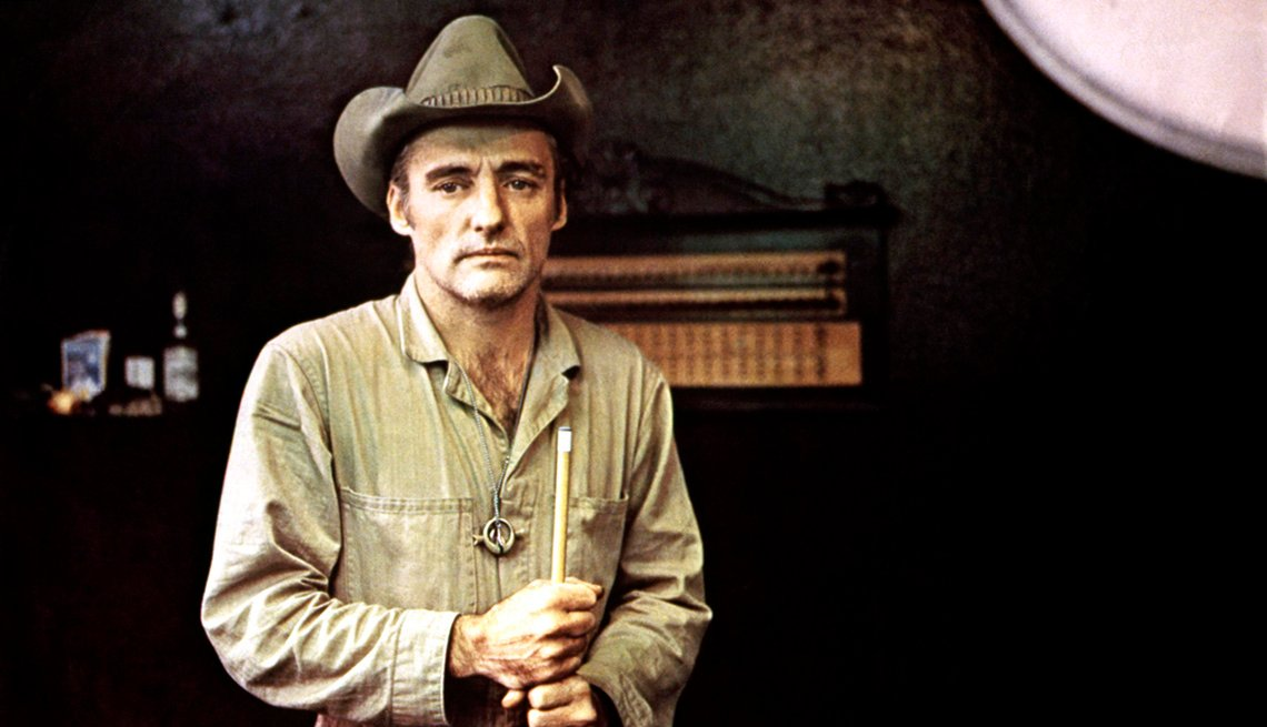 Dennis Hopper wearing a cowboy hat and holding a pool cue stick in the film The American Friend