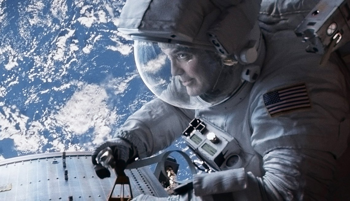 item 4 of Gallery image - George Clooney wearing a spacesuit in space in the film Gravity