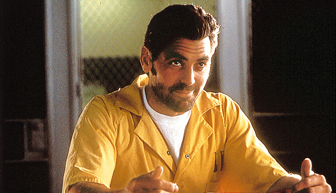 item 8 of Gallery image - George Clooney wearing a prison jumpsuit in the film Out of Sight