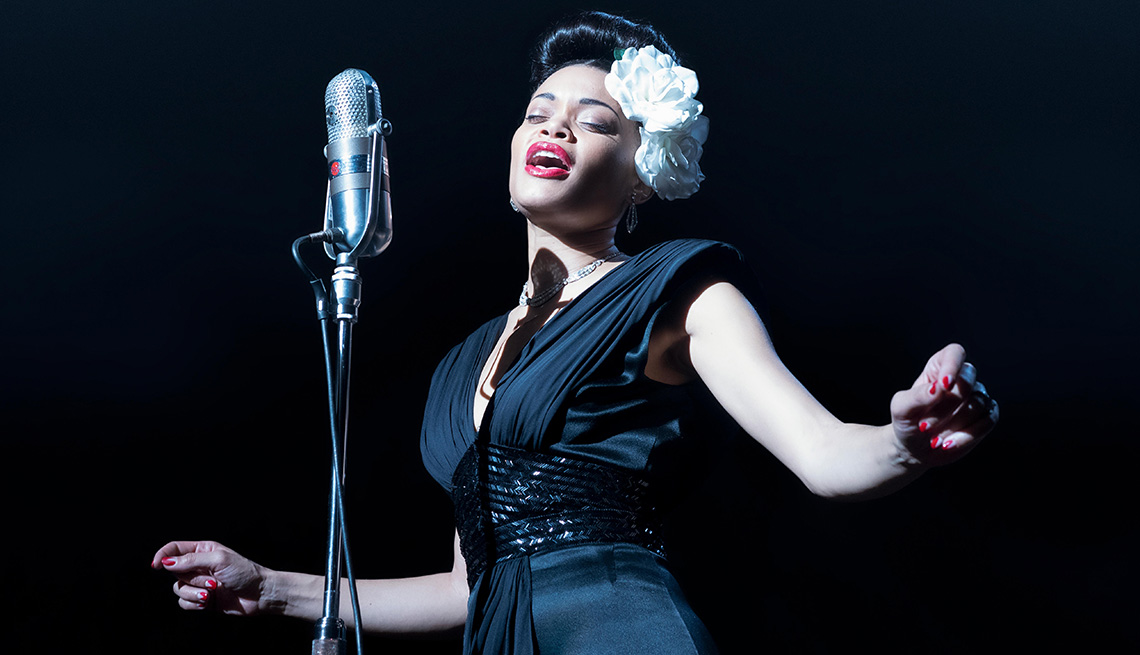 item 3 of Gallery image - Andra Day singing into a microphone in the film The United States vs. Billie Holiday