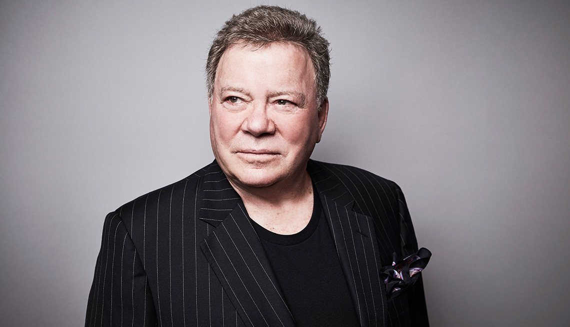 Actor William Shatner in a black striped coat jacket posing for portrait