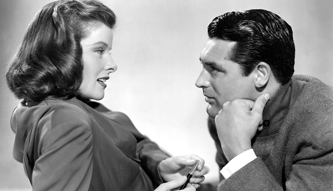 Katharine Hepburn and Cary Grant look at each other in the film Holiday