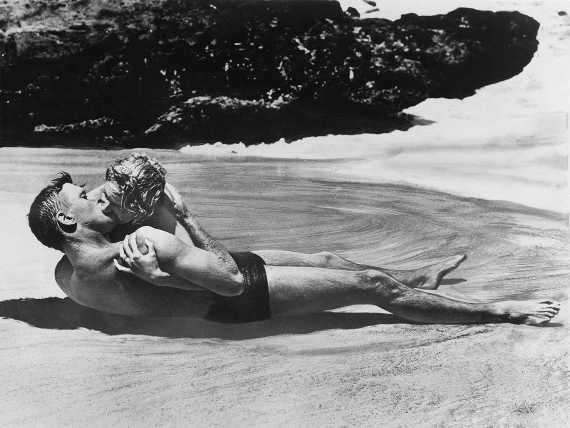 Burt Lancaster and Deborah Kerr kiss on a beach in the film From Here to Eternity