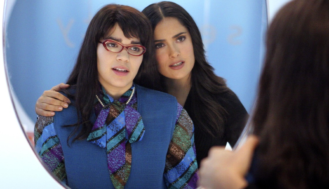 item 7 of Gallery image - Salma Hayek and America Ferrera in a scene from Ugly Betty