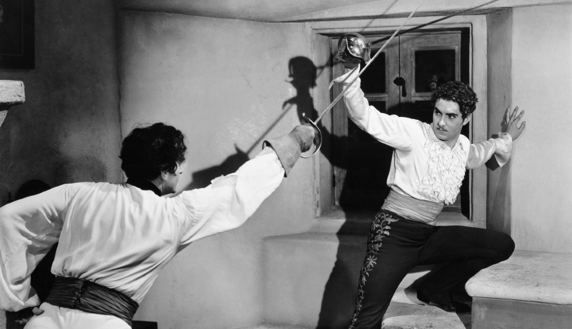 tyrone power in a fighting scene from the film the mark of zorro