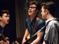 Aaron Johnson as John Lennon (center), in <i>Nowhere Boy</i>, 2009