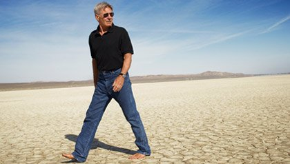 Harrison Ford walking in the desert