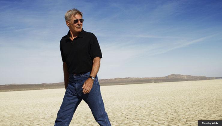 Harrison Ford walking in the desert