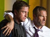 Gerard Butler y Aaron Eckhart en la película Olympus has Fallen