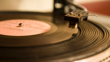 A vinyl 45 rpm record on a turntable.