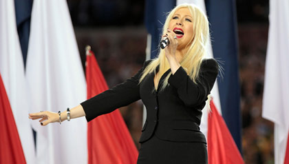 Christina Aguilera performs the National Anthem before the Super Bowl football game in 2011