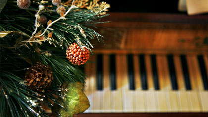AARP launches the holiday music channel on their Concord Music Internet Player- a christmas tree by a piano