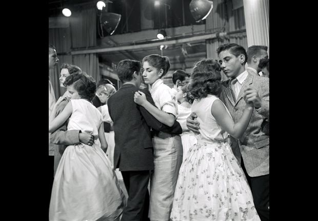 Teenagers slow dance on the television show, American Bandstand. in 1957