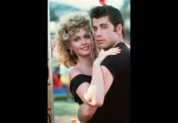 John Travolta embraces Olivia Newton-John on set of Grease.