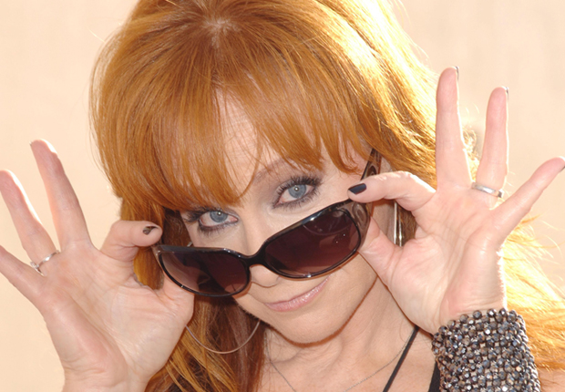Reba in 2012, and her other notable hairstyles