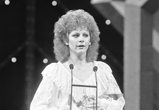 Reba in 1984, and her other notable hairstyles