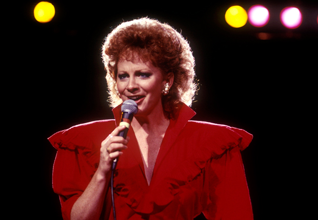 Reba in 1987, and her other notable hairstyles