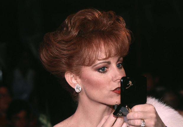 Reba in 1993, and her other notable hairstyles