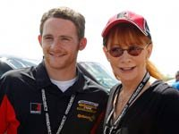 Country music star Reba McEntire, right, chats with her son Shelby Blackstock before the Continental Tire Sports Car Challenge auto race at Barber Motorsports Park on Saturday, March 31, 2012, in Birmingham, Ala.