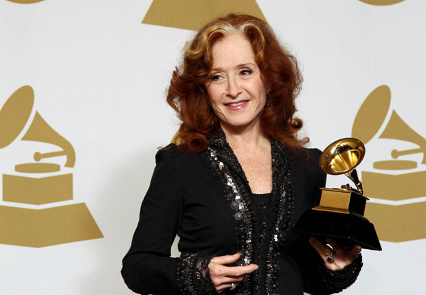 Bonnie Raitt poses backstage at the 55th annual Grammy Awards.