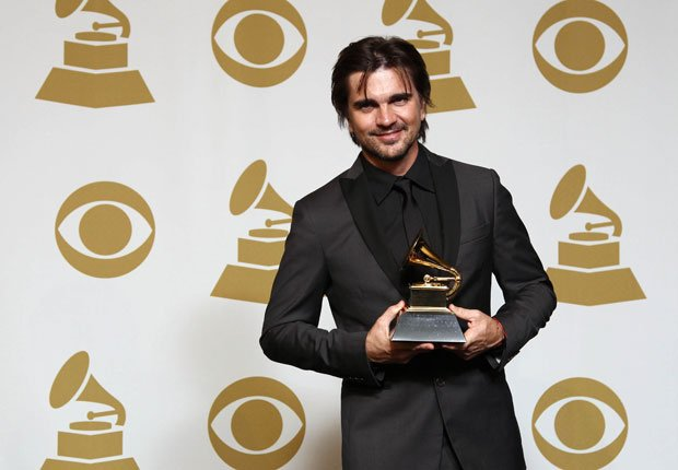 Juanes poses backstage at the 55th annual Grammy Awards.