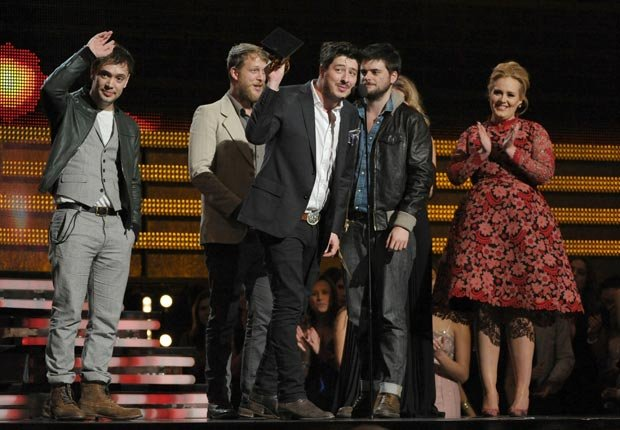 Mumford & Sons, from left, Ben Lovett, Ted Dwayne, Marcus Mumford and Country Winston Marshall accept the award for album of the year for Babel, Grammy Awards 2013