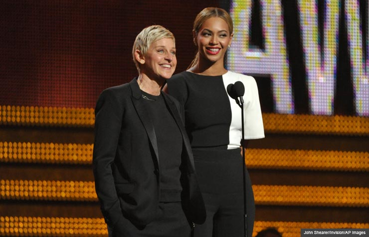 Ellen DeGeneres, left, and Beyonce speak on stage, Grammy Awards 2013