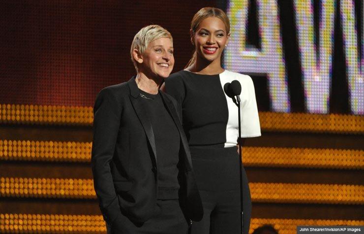 Ellen DeGeneres, left, and Beyonce speak on stage, Grammy Awards 2013