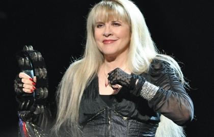 Stevie Nicks sings during a concert.