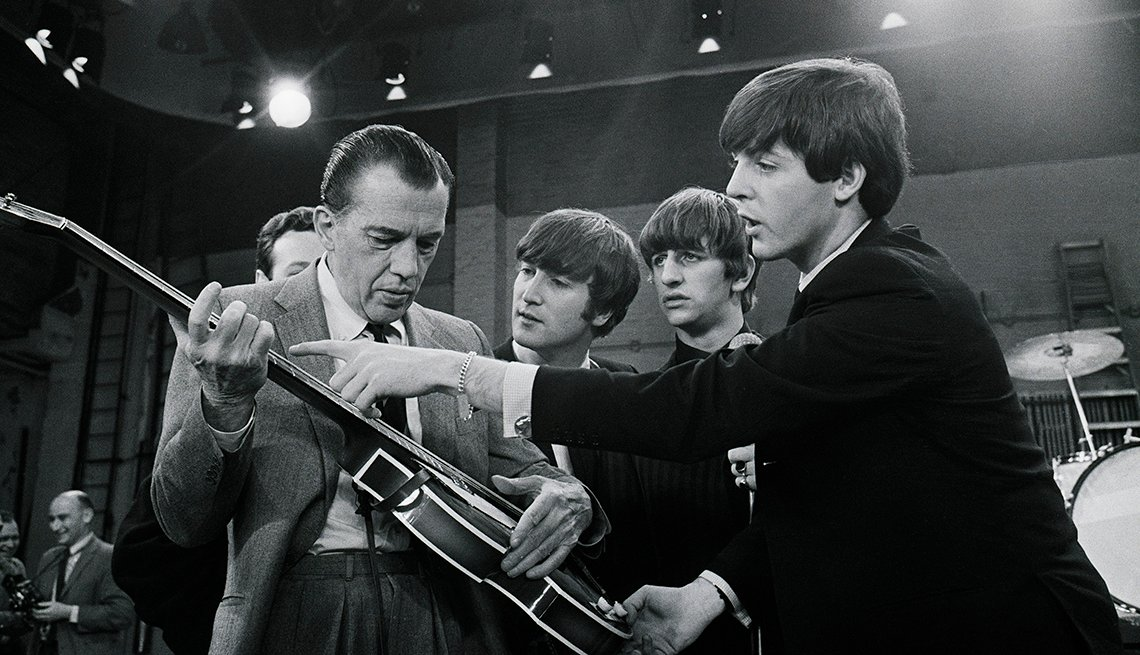 Television Host, Ed Sullivan, Paul McCartney Shows Ed Sullivan His Guitar, John Lennon And Ringo Starr In Background,The Beatles Slideshow
