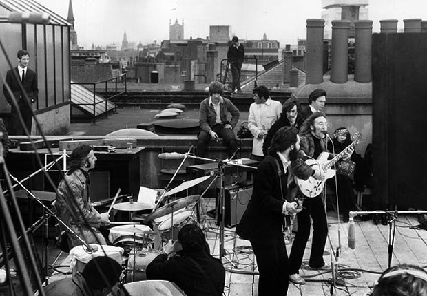 British rock group the Beatles performing their last live public concert on the rooftop of the Apple Organization.