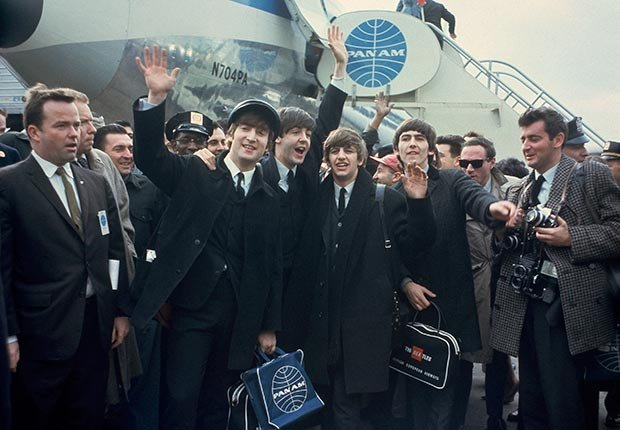 The Beatles arrive at New York's John F. Kennedy International Airport (formerly Idlewild), in New York, Feb. 7, 1964.