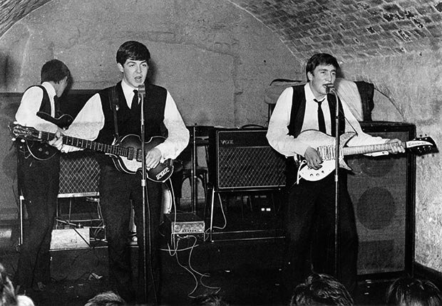 The Beatles perform at the Cavern Club in Liverpool.