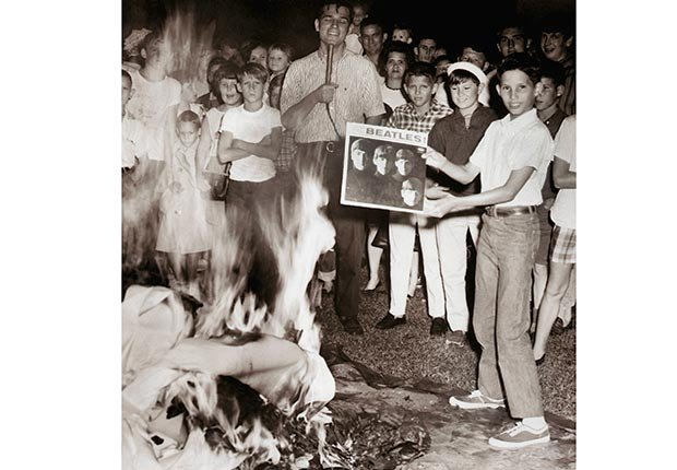 Teenagers burn albums in response to John Lennon's comment that the Beatles are more popular than Jesus Christ.